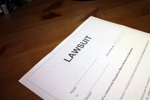 Someone reviewing/filling out Lawsuit document.