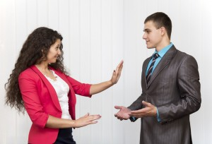 Male and female corporate co-workers are having expressive discussion